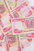 picture of ten thousand dollars  - Background of twenty five thousand iraqi dinar notes - JPG
