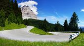 Picturesque Dolomites landscape with mountain road.