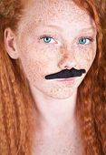 Unusual beauty with mustache