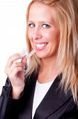 stock photo of crooked teeth  - Woman inserting dental whitening tray in her mouth - JPG