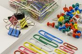 stock photo of x-files  - Colourful presentation of Office Supplies laid out in an X shape - JPG