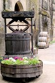 Old Wine Press And Barrels At The Vineyard
