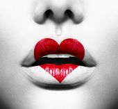 stock photo of kiss  - Beauty Sexy Lips with Heart Shape paint - JPG