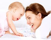 stock photo of infant  - Mother and Baby playing and Laughing - JPG