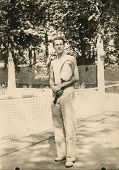 Vintage photo of man with tennis racket, forties