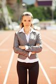 Businesswoman sport manager and executive at athletic stadium and race track