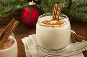 stock photo of cinnamon  - Homemade Festive Cinnamon Eggnog for the Holidays