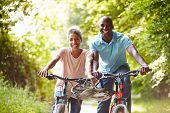 stock photo of maturity  - Mature African American Couple On Cycle Ride In Countryside - JPG
