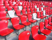 picture of bleachers  - Red chairs bleachers in large stadium - JPG