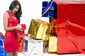 stock photo of boxing day  - Beautiful woman holding a Christmas or valentines day gift present - JPG