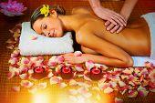 stock photo of therapist massage  - Beautiful woman having relaxing in spa massage salon - JPG