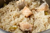 picture of dutch oven  - Salmon risotto cooking in a saucepan - JPG