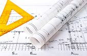 Architect rolls and plans blueprint project