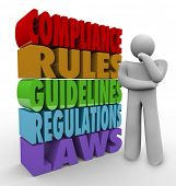 stock photo of policy  - Compliance Thinker Rules Guidelines Regulations - JPG