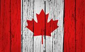 stock photo of canada maple leaf  - Canada grunge wood background with Canadian flag painted on aged wooden wall - JPG
