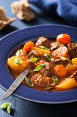 stock photo of stew  - beef stew with potato and carrot in blue plate - JPG