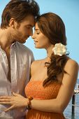 picture of romance  - Young attractive casual caucasian couple having a romantic holiday moment at the seaside - JPG
