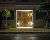 foto of front-entry  - Contemporary house entrance night view - JPG