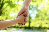 stock photo of life-support  - Mom and daughter hands - JPG