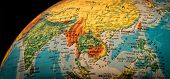 stock photo of south east asia  - A view of South East Asia on a globe against a black background - JPG