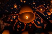 foto of floating  - Thai people floating lamp in Tudongkasatarn Chiangmai Thailand - JPG