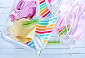 stock photo of baby cowboy  - clean baby clothes in the Laundry basket - JPG