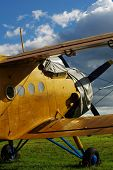 image of biplane  - Sporting biplane aircraft prepared on the tarmac - JPG