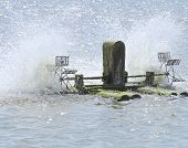 picture of aeration  - Surface aerator to greater oxygen absorption into the water at fish field - JPG
