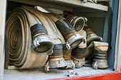 picture of fire insurance  - fire hoses equipment in firetruck - JPG