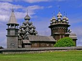 stock photo of church  - The pogost is the area inside a fence which includes two large wooden churches  - JPG