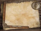 stock photo of treasure map  - Old treasure map background with compass and wood ruler - JPG