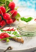 pic of curd  -  A bowl with curd and radish and a heart shaped chives decoration and brown bread - JPG