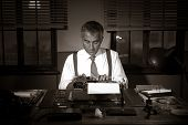 image of 1950s  - Professional handsome reporter working at office desk 1950s style.