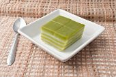 picture of chan  - Thai sweetmeat or Khanom Chan is a kind of sweet Thai dessert in white bowl on Fabric - JPG