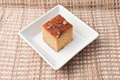 "stock photo of custard  - ""Mung Bean Thai Custard Dessert Recipe Khanom Maw Kaeng""(thai name) made with eggs and pumpkin Ancient thai dessert in white bowl on fabric - JPG"