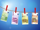 image of clotheslines  - Euro banknotes hanging on a clothesline against a sky - JPG