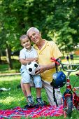 picture of grandfather  - happy grandfather and child have fun and play in park on beautiful  sunny day - JPG