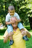 stock photo of grandfather  - happy grandfather and child have fun and play in park on beautiful  sunny day - JPG