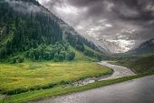 foto of jammu kashmir  - storm clouds over mountains and Indus river of ladakh green valley sccenary Jammu and Kashmir India