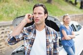 picture of breakdown  - Couple after a car breakdown at the side of the road - JPG