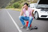 image of breakdown  - Man after a car breakdown at the side of the road - JPG
