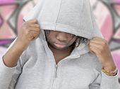 foto of hooded sweatshirt  - a rebel preteenager wearing a hooded sweatshirt - JPG