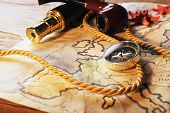 picture of spyglass  - Marine still life with world map and spyglass on wooden table background - JPG
