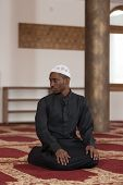 pic of god  - African Muslim Man Making Traditional Prayer To God While Wearing A Traditional Cap Dishdasha - JPG