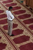 foto of muslim man  - Black African Muslim Man Is Praying In The Mosque - JPG