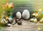 pic of nostalgic  - Vintage easter decoration with golden eggs and red tulip flowers - JPG