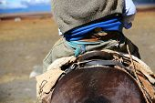 picture of gaucho  - Back view of gaucho riding horse - JPG