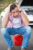 picture of nervous breakdown  - Stressed man after a car breakdown at the side of the road - JPG