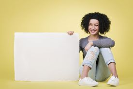 picture of sign-boards  - Cheerful young woman being happy presenting a blank white paper sign board - JPG