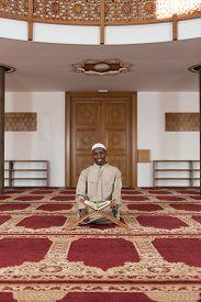foto of islamic religious holy book  - Black African Muslim Man Reading Holy Islamic Book Koran  - JPG